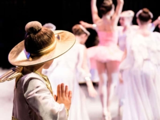 Angel praying while watching The Sugar Plum Princess in The Nutcracker ballet.