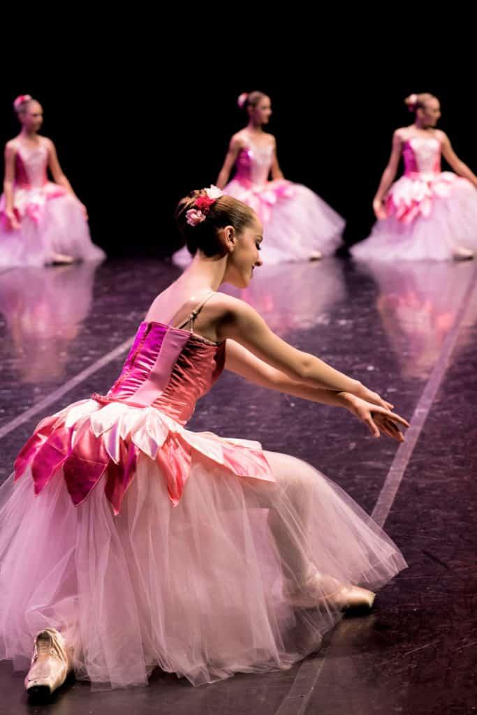 Flower dancer in The Nutcracker wilting on stage.