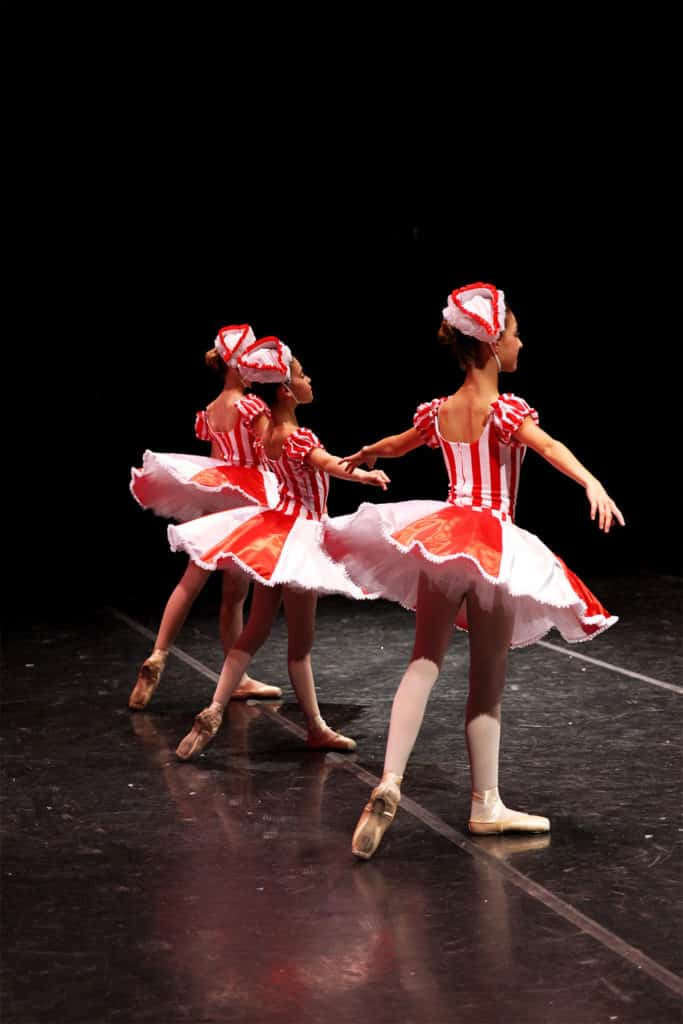 3 Marzipan dancers on stage in The Nutcracker Ballet.