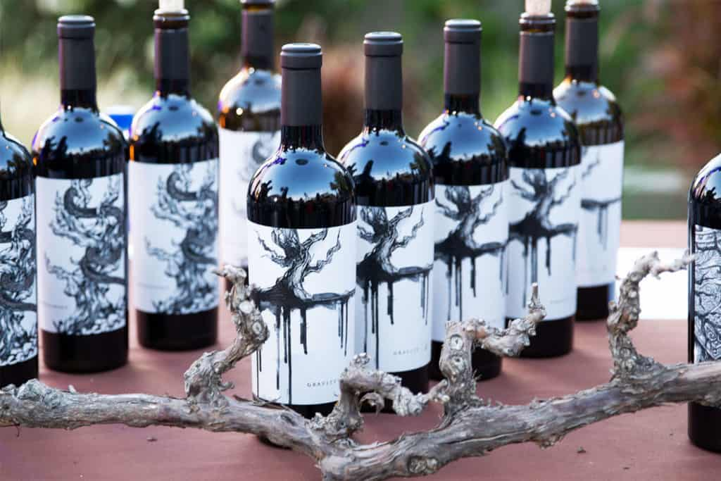 Ten bottles of Mount Peak Rattlesnake Zinfandel wine bottles on a table.