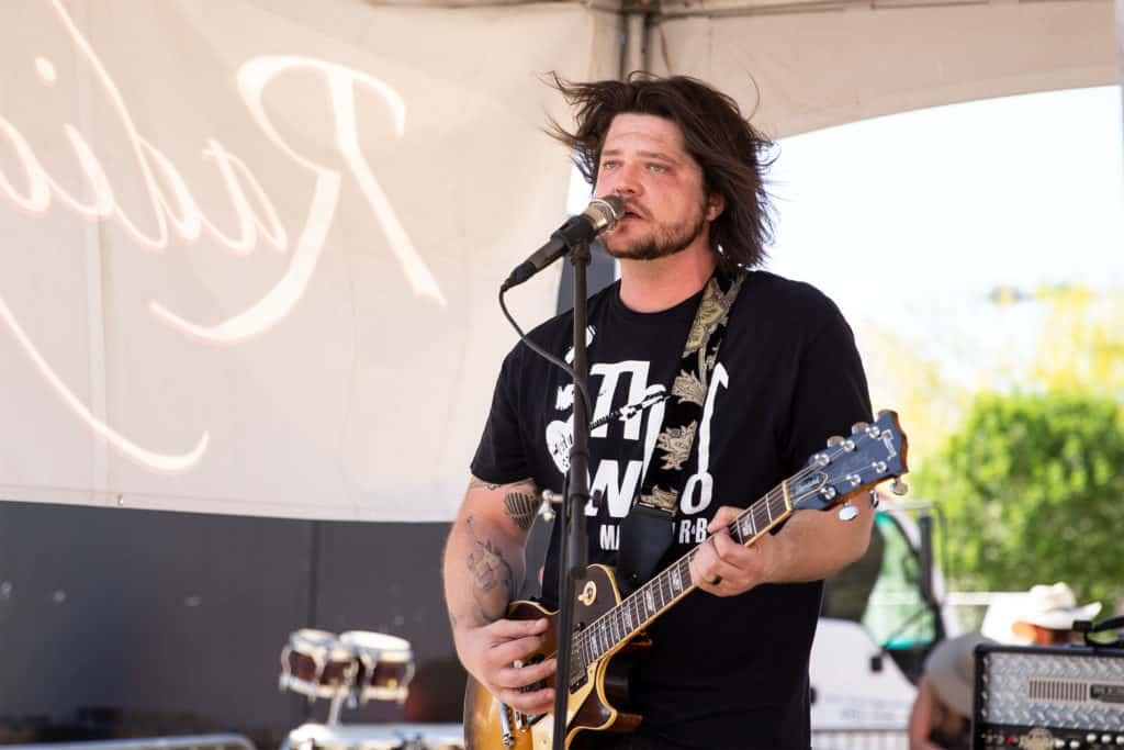 Lead singer of RadioFix band performing at an event in Phoenix, Arizona.