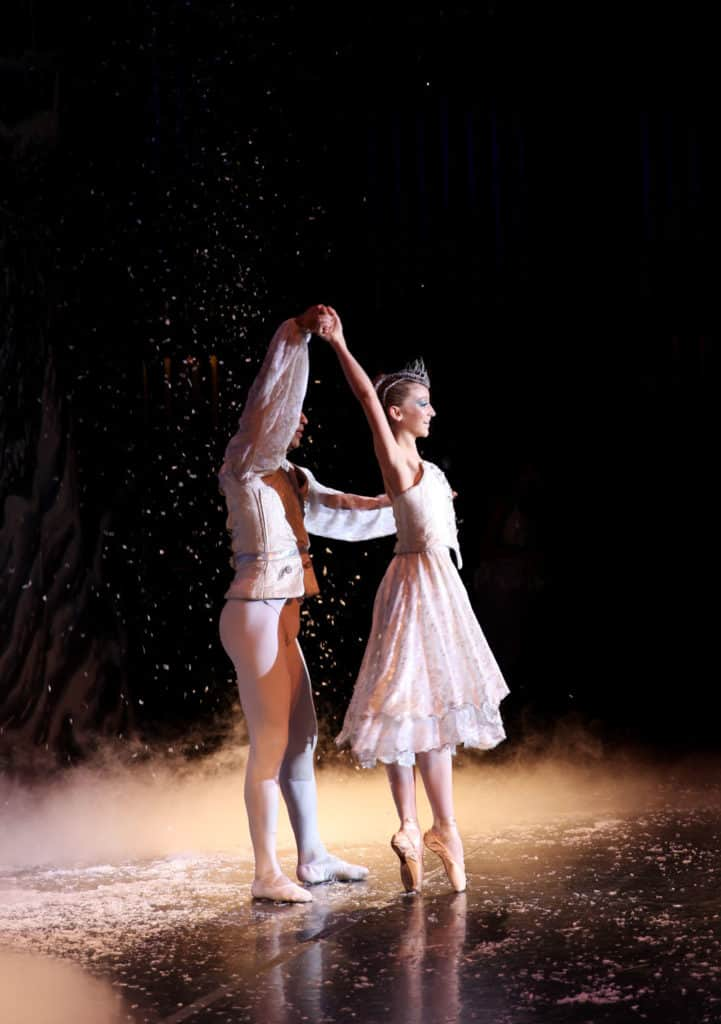 Snow Queen dancing on pointe in The Nutcracker ballet.