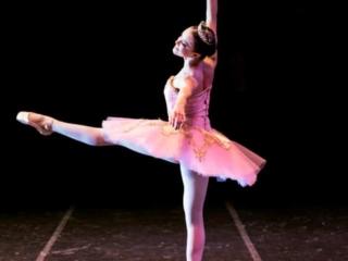 Sugar Plum Princess dancing on stage in The Nutcracker.