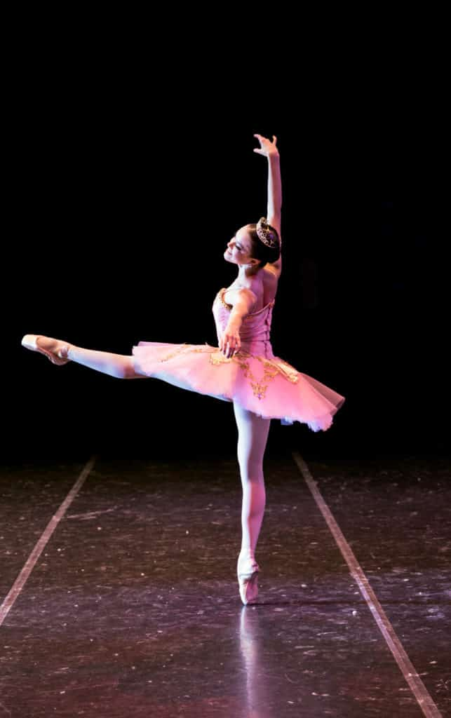 Sugar Plum Princess dancing on stage in The Nutcracker.